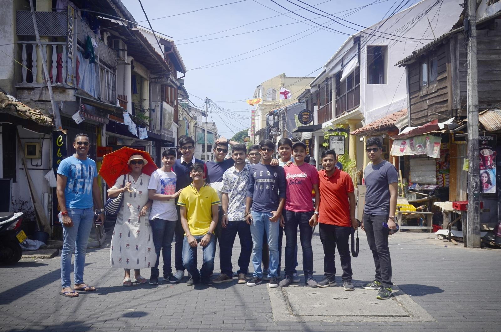 A group of Indian students is posing in the street during their tailor made volunteering trip abroad with Projects Abroad.